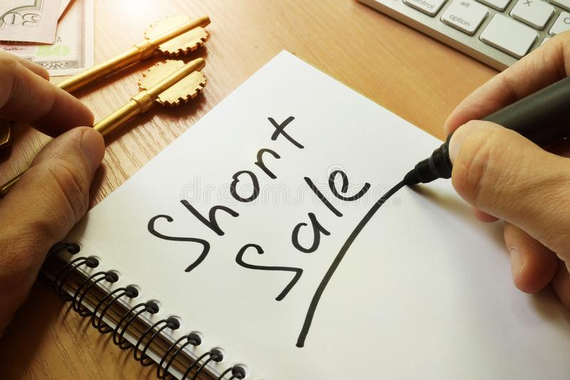 Short sale handwritten in a note. stock image