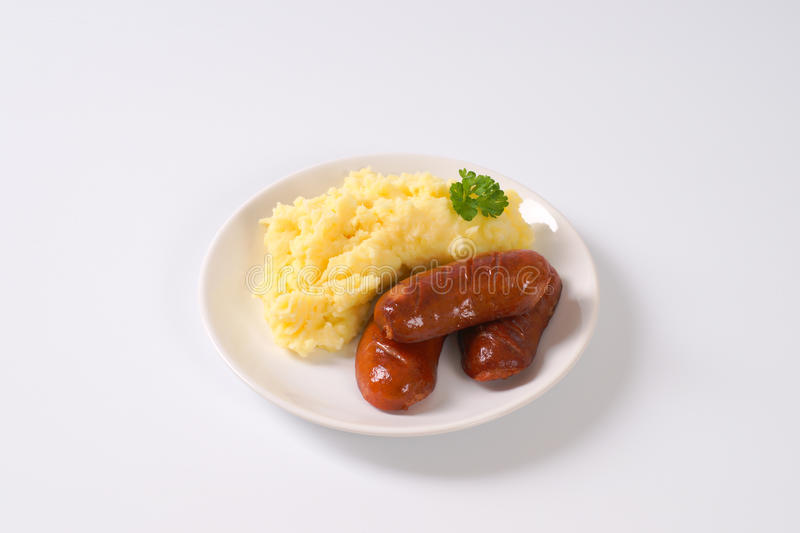 Short thick sausages with mashed potatoes stock photos