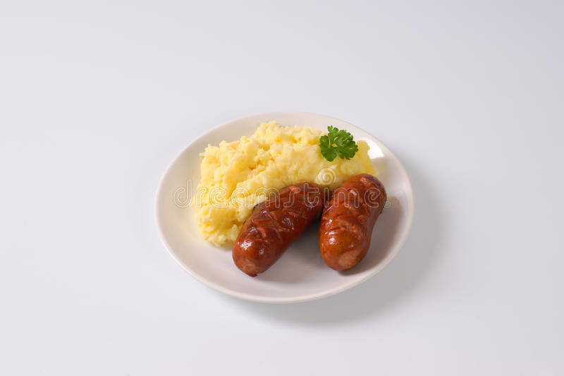 Short thick sausages with mashed potatoes stock photo
