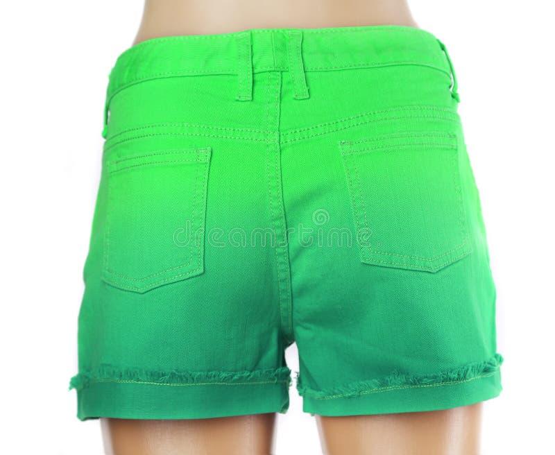 Short verde das calças de brim das mulheres. imagens de stock royalty free