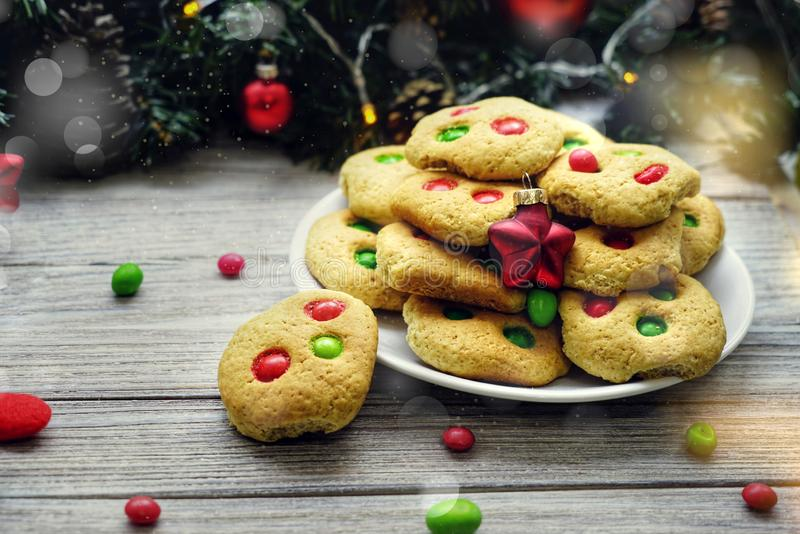 Shortbread cookies with multi colored candy and chocolate chips, served with glass of milk, square format.  stock photos