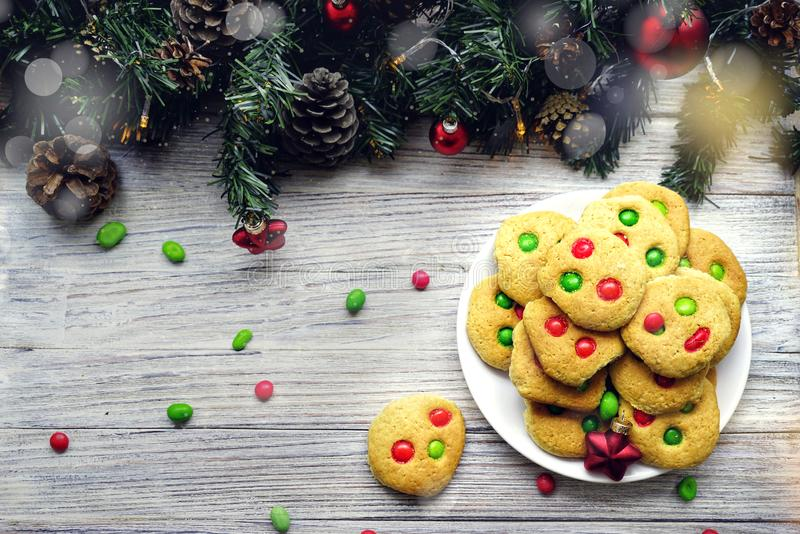 Shortbread cookies with multi colored candy and chocolate chips, served with glass of milk, square format.  stock image