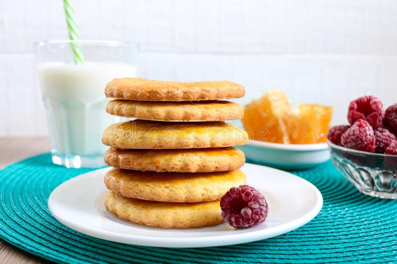 Shortbread dairy cookies with milk and honey. A stack of cookies on a plate stock photos