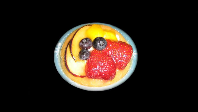 Shortcrust pastry tart with fruit and custard. royalty free stock photo