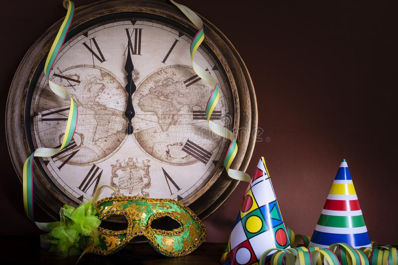 Shortly before twelve to New Year`s Eve. With party decoration royalty free stock photography