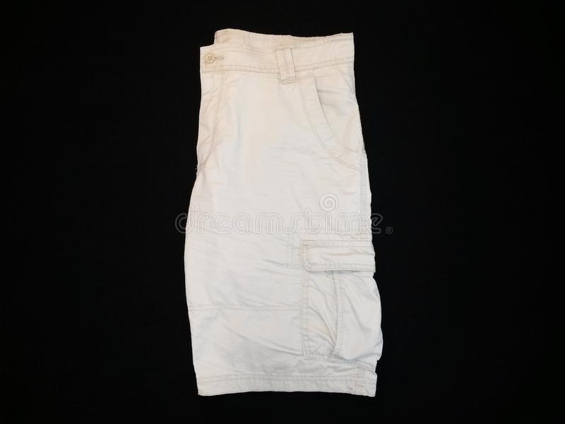 Shorts beige, lateral side, on black background stock photography
