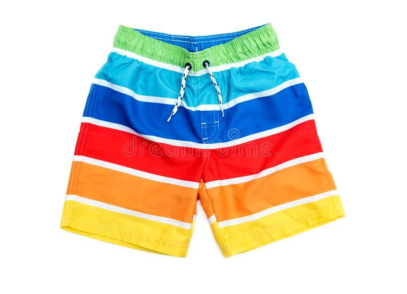 Swimming shorts for boy in stripes of different colors. Shorts for swimming on a white background isolated stock photography
