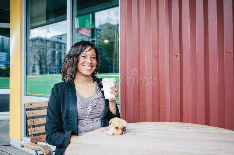 African American businesswoman holding a cup of coffee for breakfast royalty free stock photography