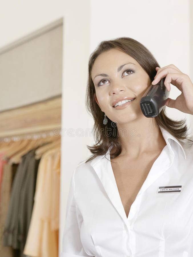 Download Shot Attendant on Phone stock image. Image of managing - 25672185
