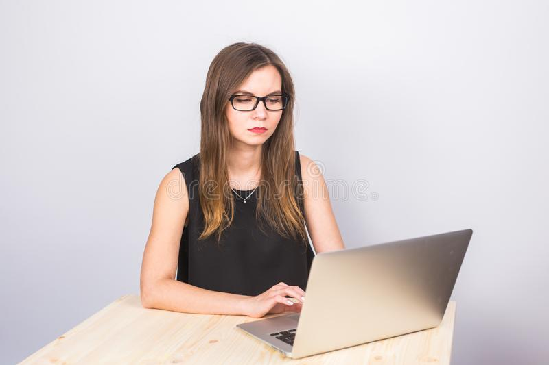 Attractive mature businesswoman working on laptop in her workstation. stock images