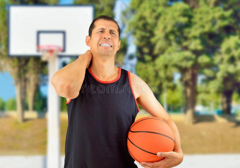 Player basketball with injured neck royalty free stock photo