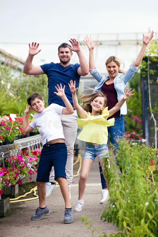 Beautiful family playing and enjoying time in the greenhouse. royalty free stock photography
