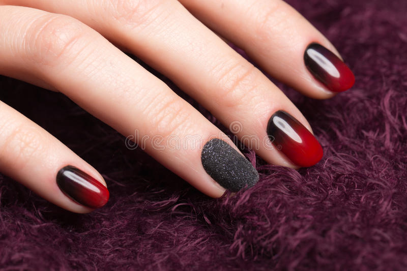 Shot beautiful manicure with gradient on female fingers. Nails design. Close-up. Picture taken in the studio stock photo