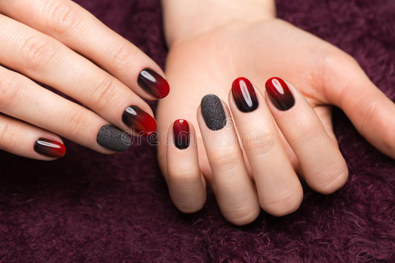 Shot beautiful manicure with gradient on female fingers. Nails design. Close-up. Picture taken in the studio royalty free stock photography