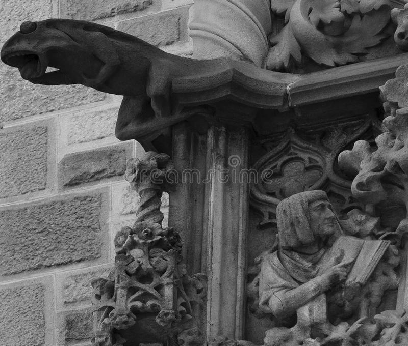 Lizard squealing on the corner. Shot in black and white detail on the sculpture on the facade of this historic building representing some characters / animals / royalty free stock images