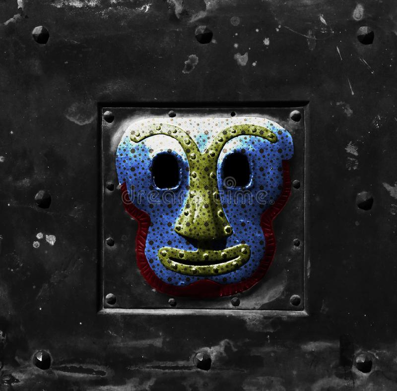 Smiling iron face by the door stock images