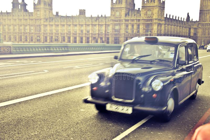 Shot Of A Blue Classic Car Near Westminster Palace in London, England. A Shot Of A Blue Classic Car Near Westminster Palace in London, England royalty free stock photography