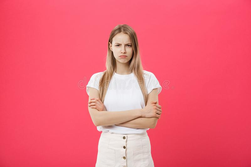 Shot of bored annoyed beautiful teenage girl with straight blond hair looking at camera with boring and annoying face royalty free stock photography