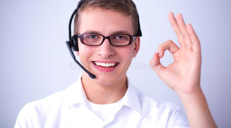 Shot of a call center operator showing ok.  royalty free stock photo