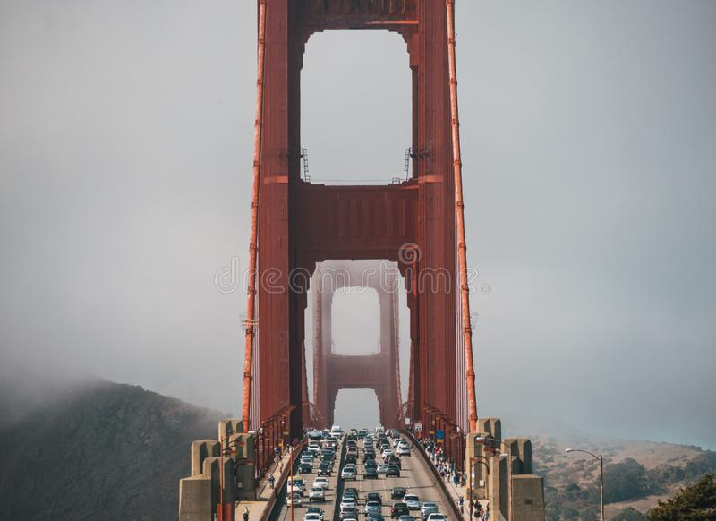 Shot of cars on the Golden Gate Bridge covered in fog in San Francisco, California, USA stock image