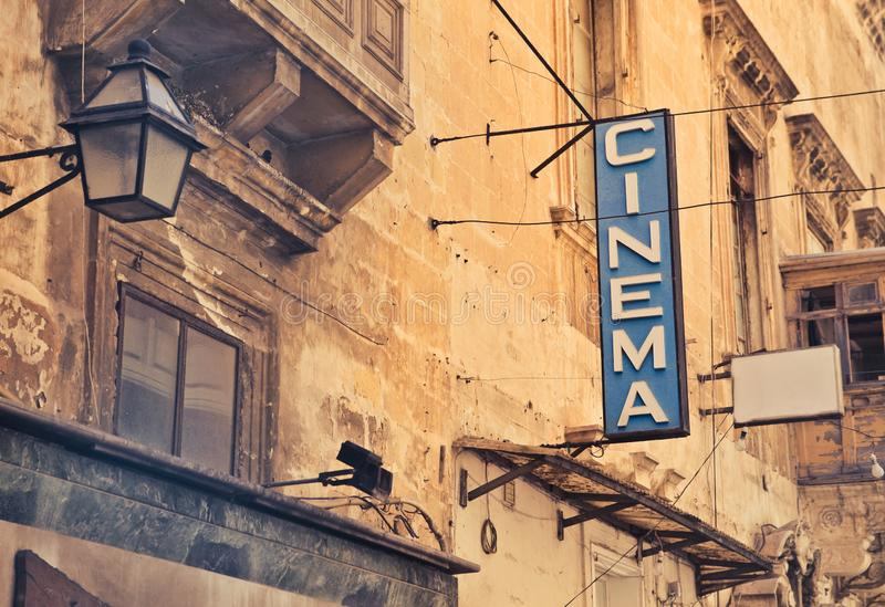 Shot of cinema sign on a brown building stock images
