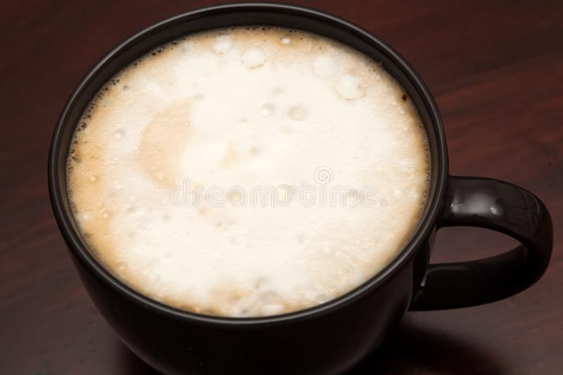 Coffee latte on wooden background. Shot of coffee latte on wooden background royalty free stock photo