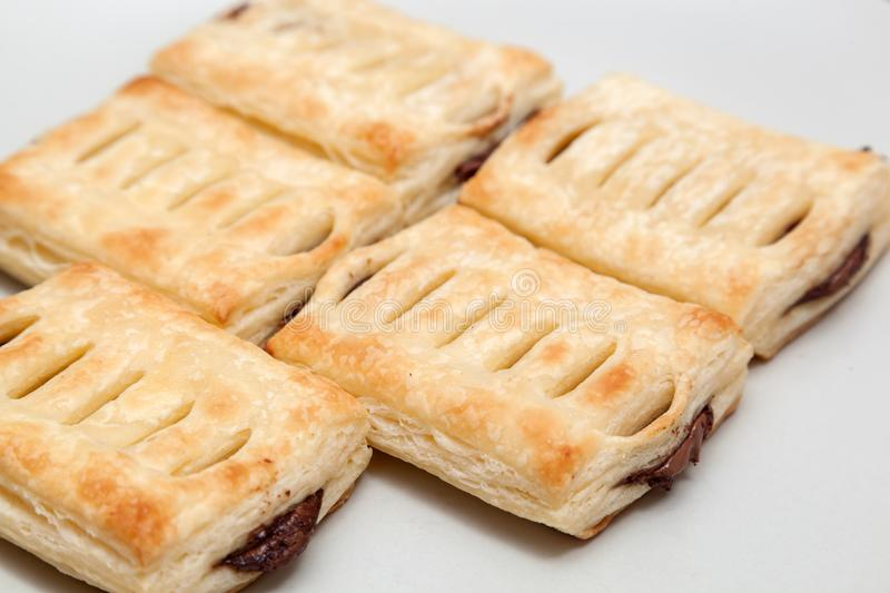 Chopped pastry with chocolate. Shot of copped pastry with chocolate on wooden table royalty free stock photo