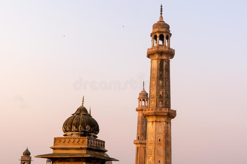 Shot of dome and spires of a mosque. Shot of the domed roof and spires or minars of Asfi mosque shot from the famous rooftop of bara imambara in Lucknow uttar royalty free stock image