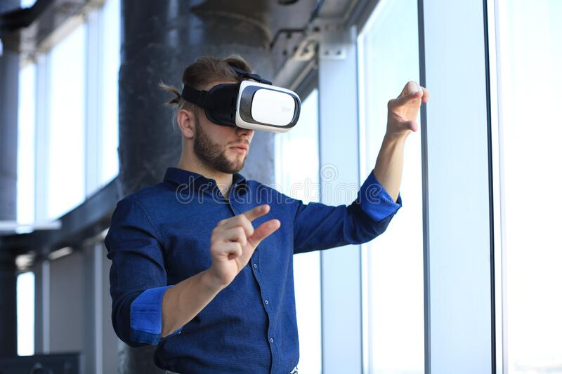Shot of an engineer wearing a VR headset in an new building. Change the way you see and experience the world.  royalty free stock photos