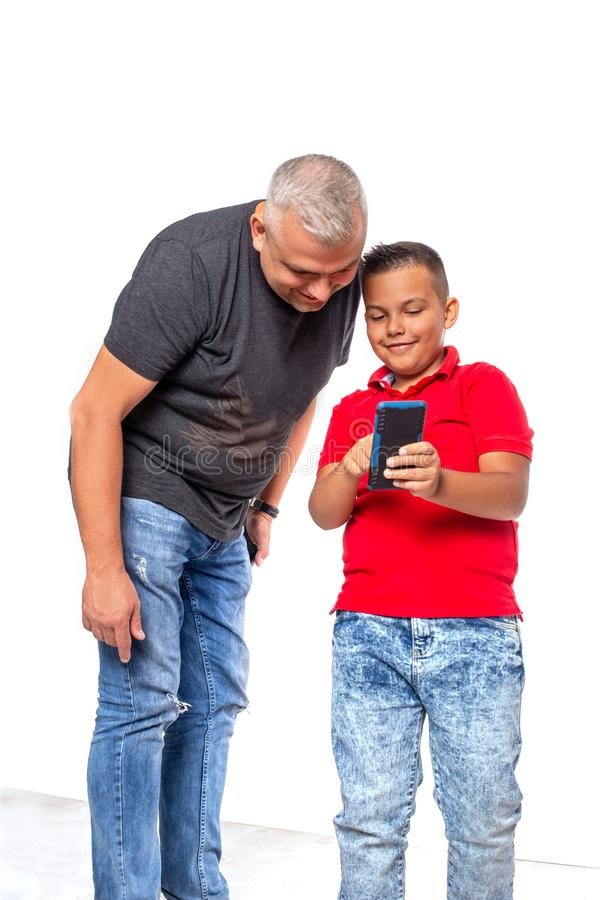 Shot of a father and son browsing on a phone together, isolated royalty free stock photos