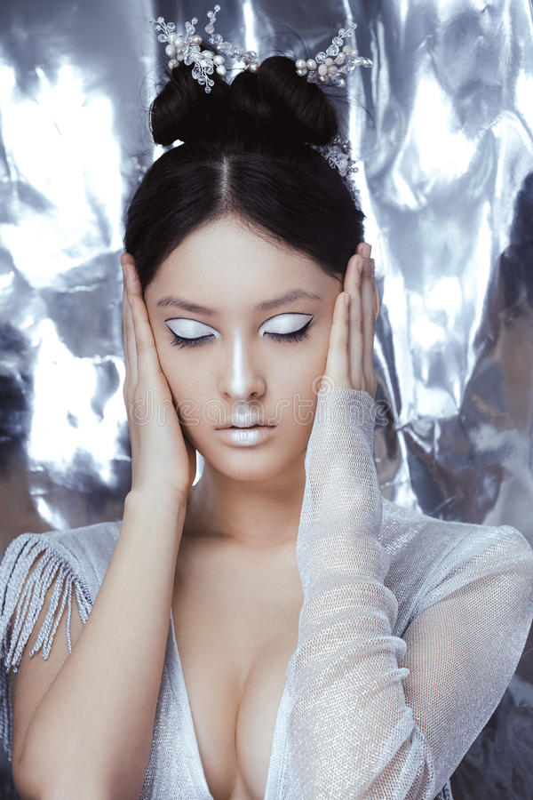 Shot of a futuristic young asian woman. stock images