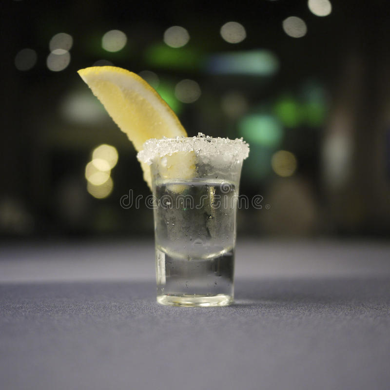 Shot glass of tequila royalty free stock image