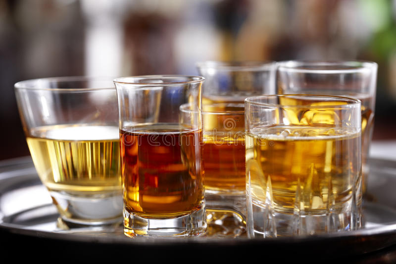 Download Shot glasses stock image. Image of orange, beverage, amber - 14640055