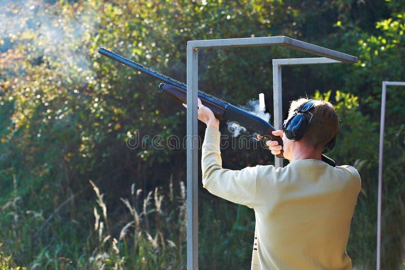 Download Shot from gun stock photo. Image of shooter, rifle, return - 16454644
