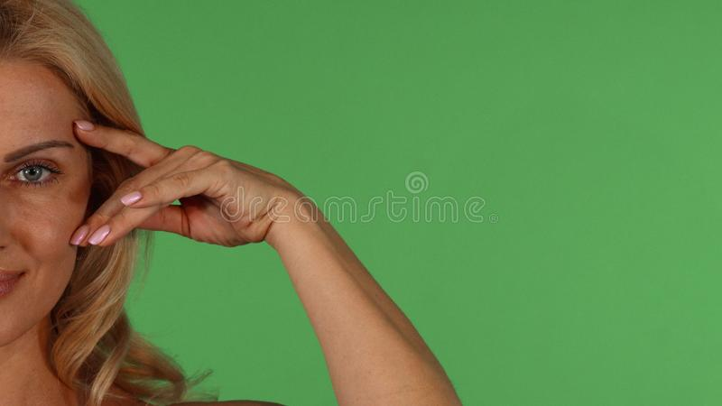 Shot of a half of face of gorgeous mature woman stock photos