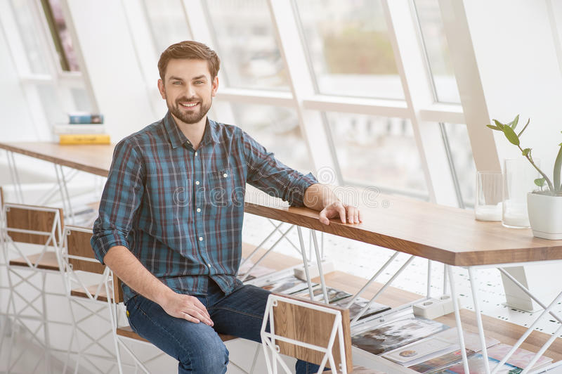 Shot of handsome young businessman in office stock images