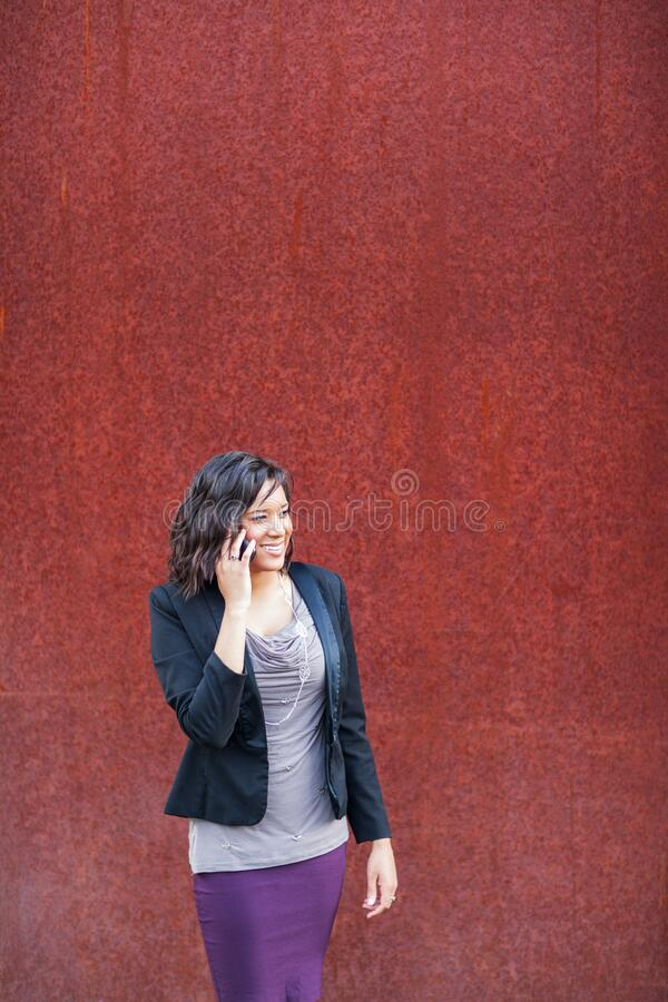 Happy African American businesswoman talking on the phone stock image