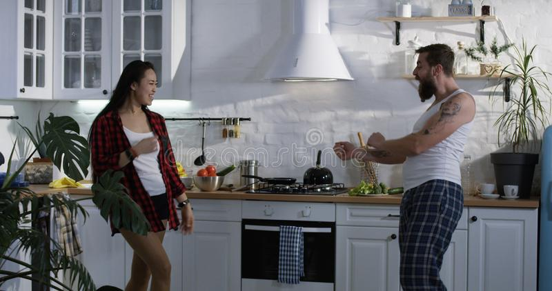 Couple dancing in the kitchen stock images