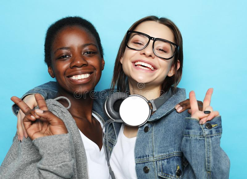 Shot of happy interracial homosexual couple hugging. African-American girl and her charming Caucasian girlfriend. People and relationship concept stock photography