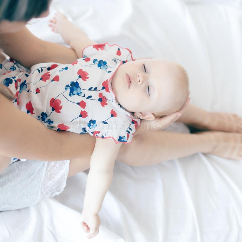 Shot of happy mother holding her baby girl. Summer vacation stock photos