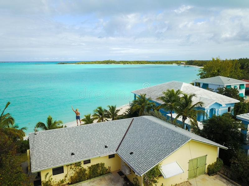 Shot of houses by the sea surrounded with palm trees in Exuma. A shot of houses by the sea surrounded with palm trees in Exuma royalty free stock images