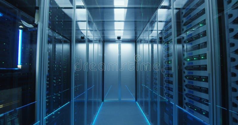 Long hallway full server racks in a modern data center royalty free stock image