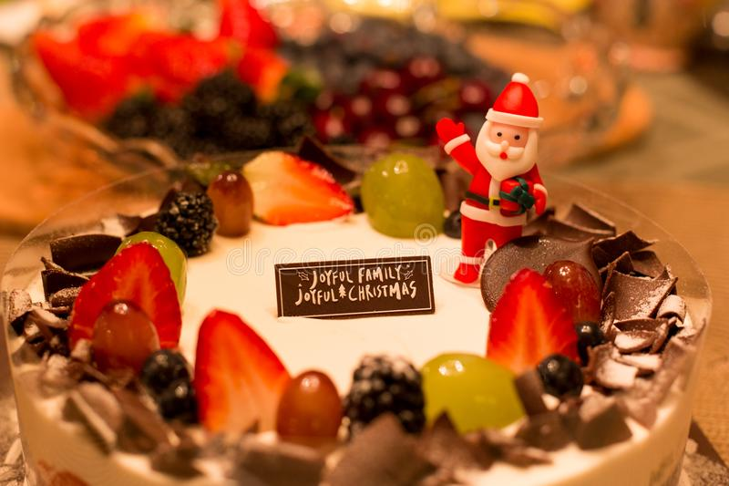 Shot in low light with high ISO Christmas fruit cake and new yea. R with word and Santa Claus royalty free stock photo