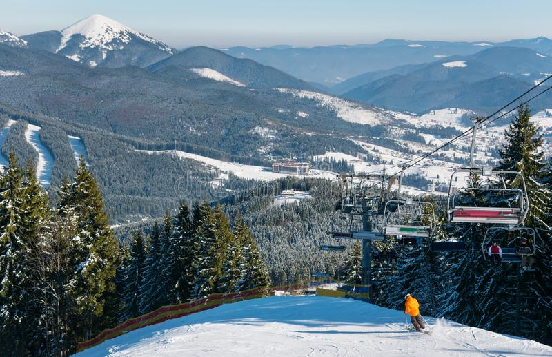 Skier skiing in the mountains stock photo