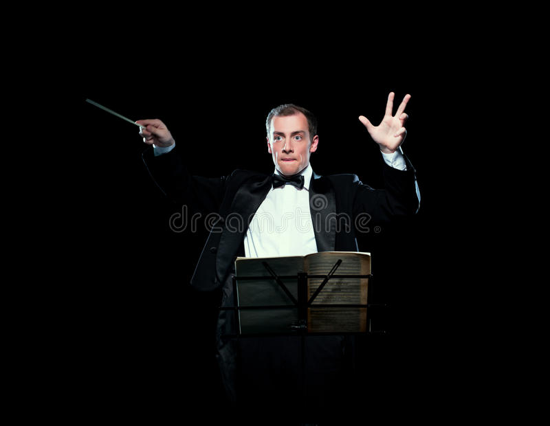 Shot of music director conducting with inspiration. Studio photo of music director conducting with inspiration royalty free stock images
