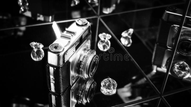 Shot of old photography camera in the mirror royalty free stock photography