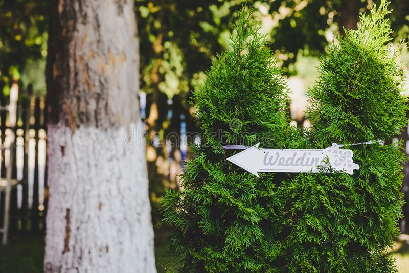 Wedding sign in the forest. This shot represents a wedding sign in the forest area stock photography