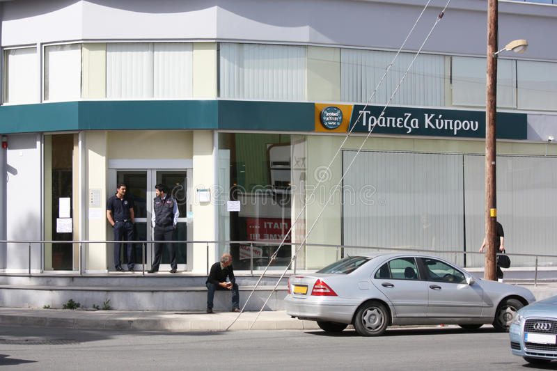 Shot of Bank of Cyprus. A shot showing a branch of Bank of Cyprus, with security personnel standing outside to make sure that people will not interfere with the stock photos