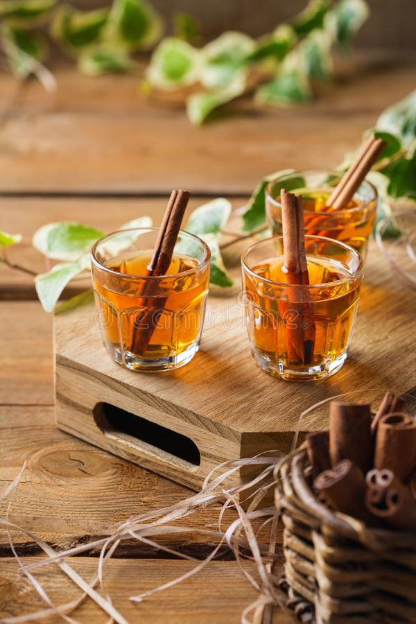 Shot with strong alcohol and cinnamon on a wooden table stock photography
