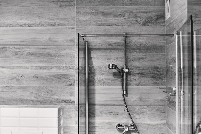 Shot of a stylish black and white bathroom with a shower head stock photo